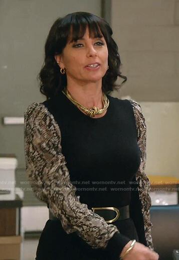 Kathleen's black snake print sleeve top on Good Trouble
