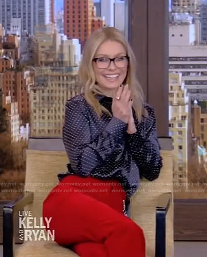 Kelly's studded blouse and red pants on Live with Kelly and Ryan