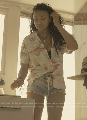 Kiara's printed button up shirt and denim shorts on Outer Banks