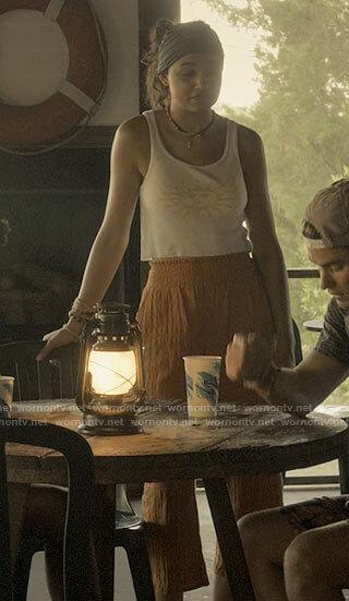Kiara's sun top and orange pants on Outer Banks