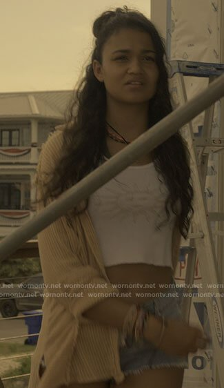 Kiara's yellow striped shirt, sun top and denim lace-up shorts on Outer Banks