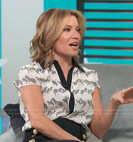 Kit's zebra print blouse and button detail pants on Access Hollywood