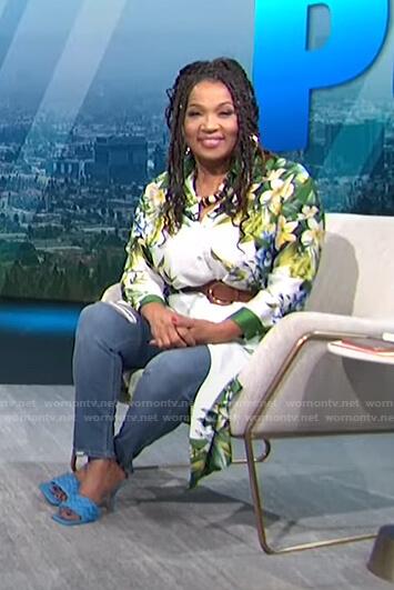 Kym's white floral shirdress on E! News Nightly Pop