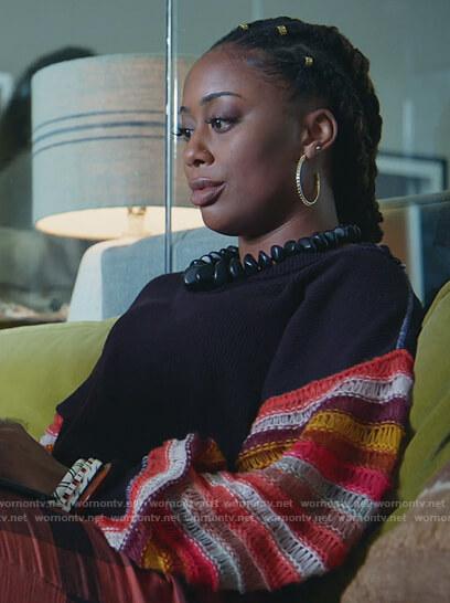 Malika's blue stripe sleeve sweater on Good Trouble