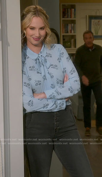 Mandy's blue floral blouse and grey jeans on Last Man Standing