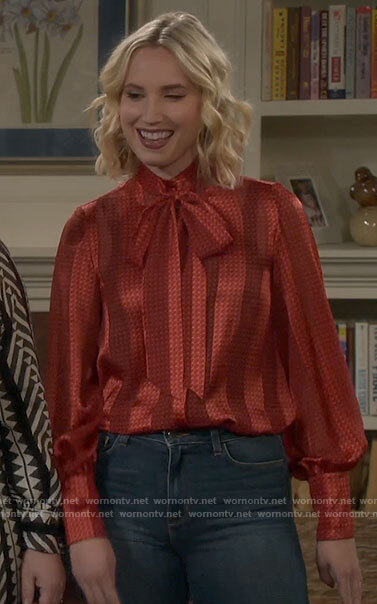 Mandy's red striped tie neck blouse on Last Man Standing