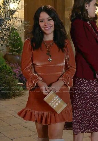 Mariana's orange velvet mini dress on Good Trouble