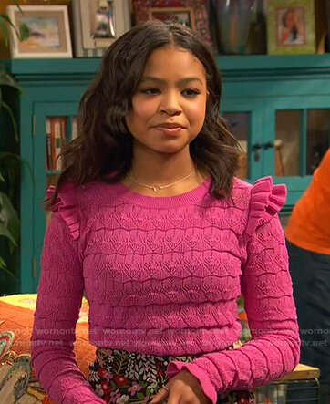 Nia's pink ruffle knit sweater on Ravens Home