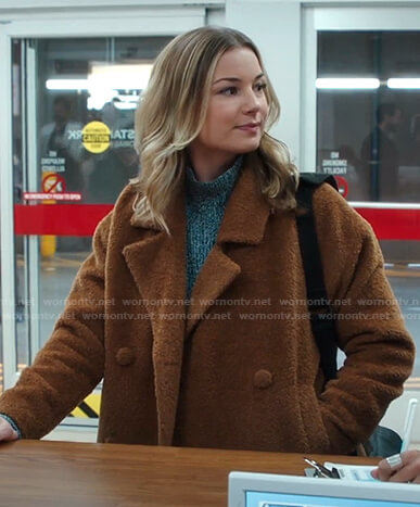 Nic's marled sweater and brown jacket on The Resident