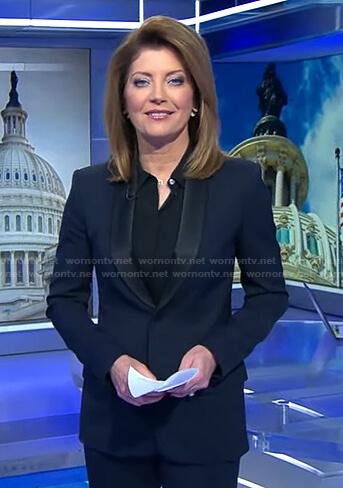 Nora's navy contrast shawl collar blazer on CBS Evening News