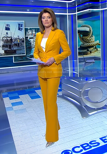 Norah's yellow belted suit on CBS Evening News