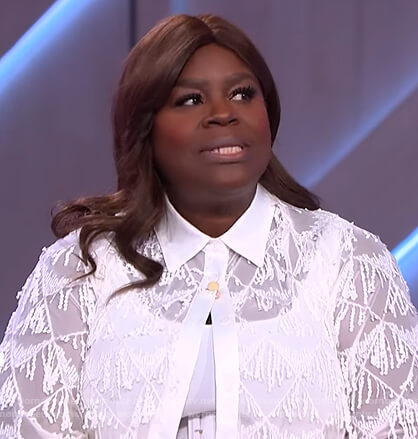 Retta's white fringe trim blouse and pants on The Kelly Clarkson Show