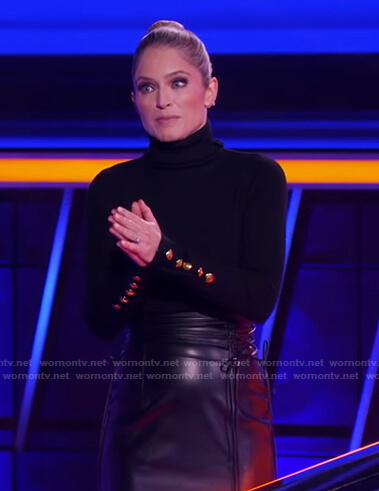 Sara's black turtleneck sweater with gold buttons and skirt on The Chase