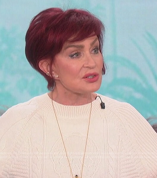 Sharon's white skull knit sweater on The Talk