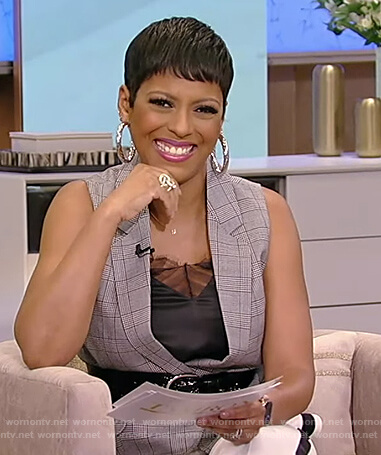 Tamron's gray plaid vest and white pants on Tamron Hall Show