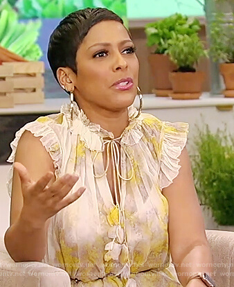 Tamron's yellow floral ruffled dress on Tamron Hall Show