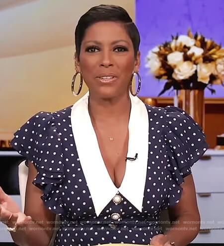 Tamron's navy polka dot contrast dress on Tamron Hall Show