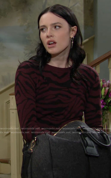 Tessa's red tiger stripe sweater and spike earrings on The Young and the Restless