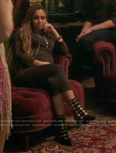 Toni's black brass buckle boots on Riverdale