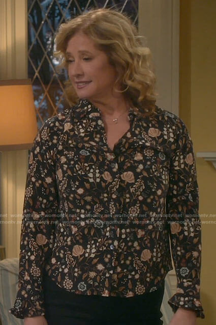 Vanessa's black floral button down blouse on Last Man Standing