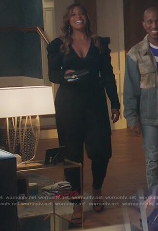 Mika's black puff sleeve jumpsuit on Kenan