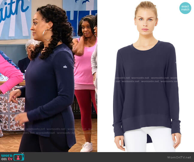 Glimpse Long Sleeve Top by Alo Yoga worn by Cocoa McKellan (Tia Mowry-Hardrict) on Family Reunion