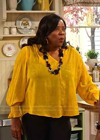 M'Dear's yellow floral smocked cuff blouse on Family Reunion