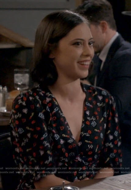 Adriana's black printed romper on B Positive