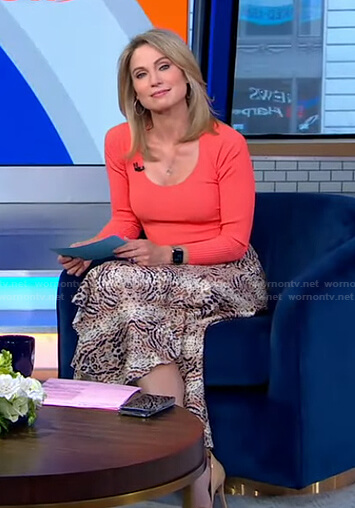 Amy's orange scoop neck top and animal print skit on Good Morning America