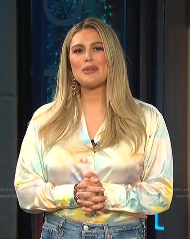 Carissa's tie dye satin blouse and distressed jeans on E! News Daily Pop