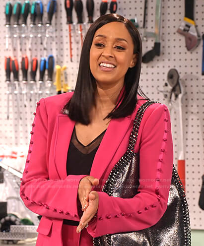 Cocoa's pink button-sleeve blazer and pants on Family Reunion