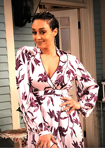 Cocoa's pink floral wrap dress on Family Reunion