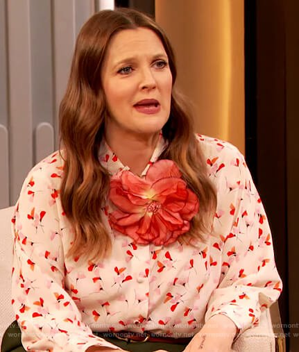 Drew's floral print blouse and green flare pants on The Drew Barrymore Show
