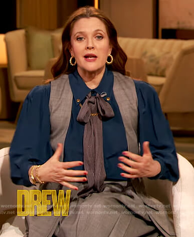Drew's navy blouse with chain detail on The Drew Barrymore Show