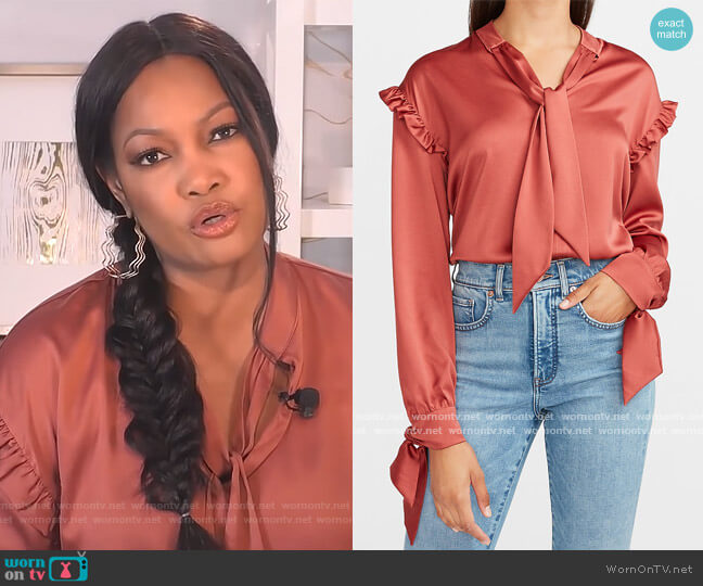 Satin Ruffle Tie Neck Top by Express worn by Garcelle Beauvais  on The Real
