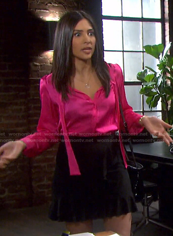 Gabi's pink tie neck blouse and ruffle mini skirt on Days of our Lives