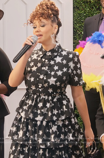 Jade's black metallic star print dress on Family Reunion