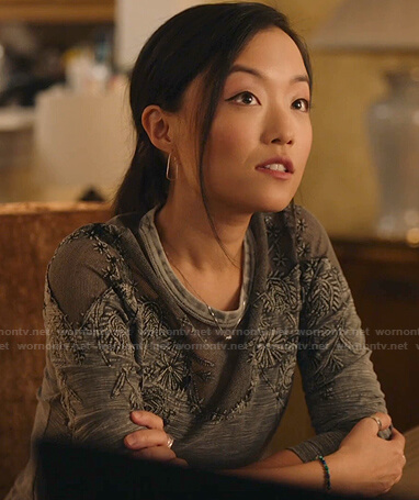 Janet's grey embroidered top on Kims Convenience