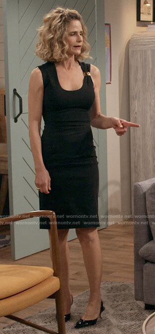 Jean's black dress with gold cuff on Call Your Mother