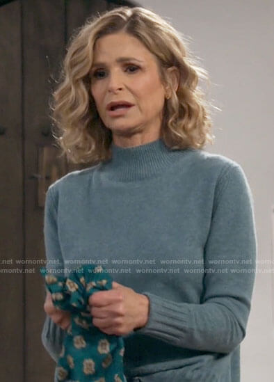Jean's blue sweater on Call Your Mother