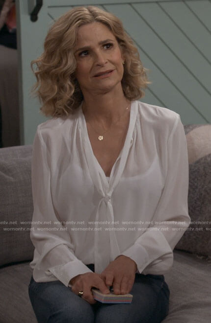 Jean's white tie neck blouse on Call Your Mother