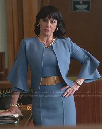 Kathleen's blue sheath dress and ruffle sleeve jacket on Good Trouble