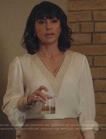 Kathleen's white eyelet trim v-neck blouse on Good Trouble