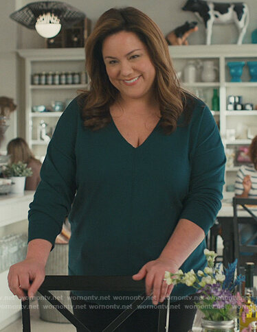 Katie's teal v-neck sweater on American Housewife