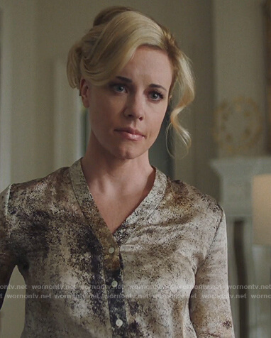 Kelly Anne's printed satin blouse on Queen of the South