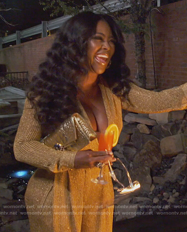 Kenya's gold metallic wrap dress on The Real Housewives of Atlanta
