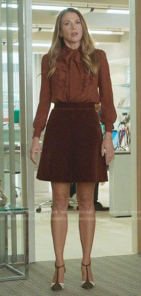 Liza's brown ruffled blouse and velvet skirt on Younger