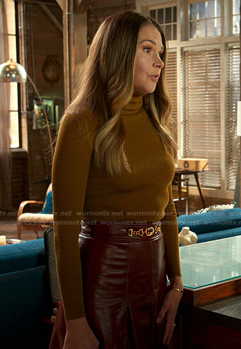 Liza's mustard turtleneck sweater and leather skirt on Younger