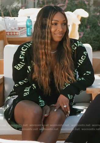 Malika's black Balenciaga logo cardigan on Keeping Up with the Kardashians