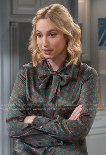 Mandy's green printed tie neck blouse on Last Man Standing